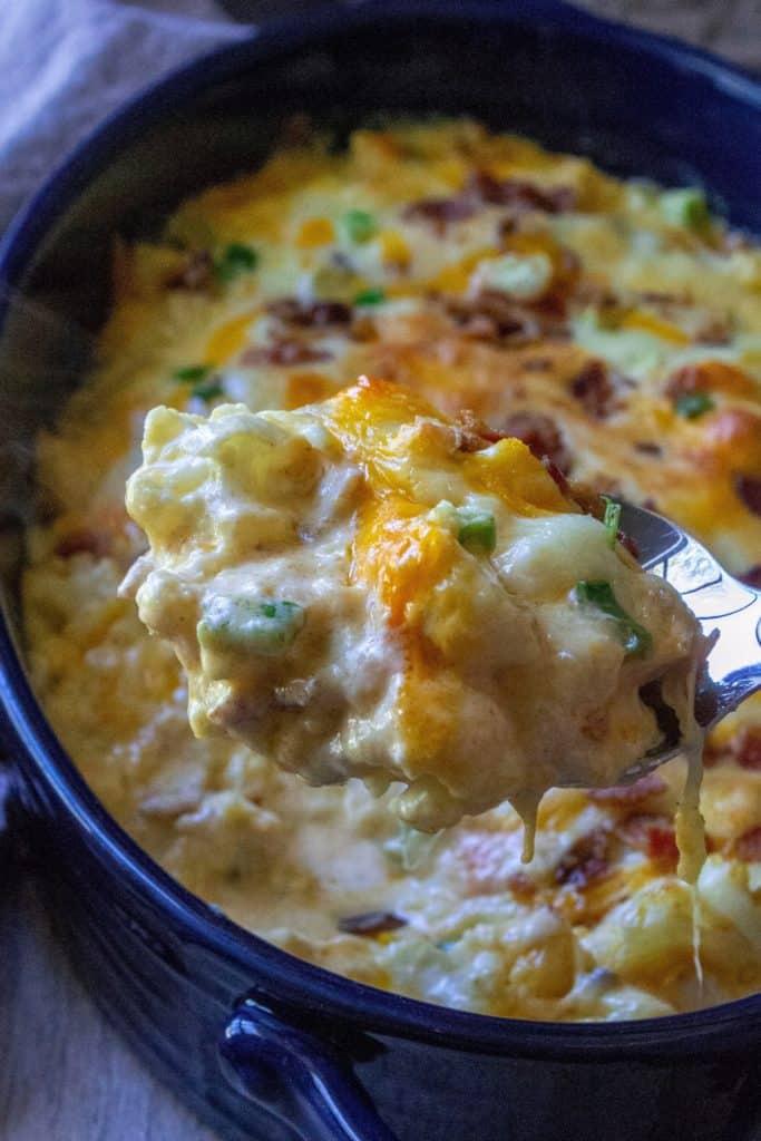Loaded Cauliflower Casserole on a serving spoon
