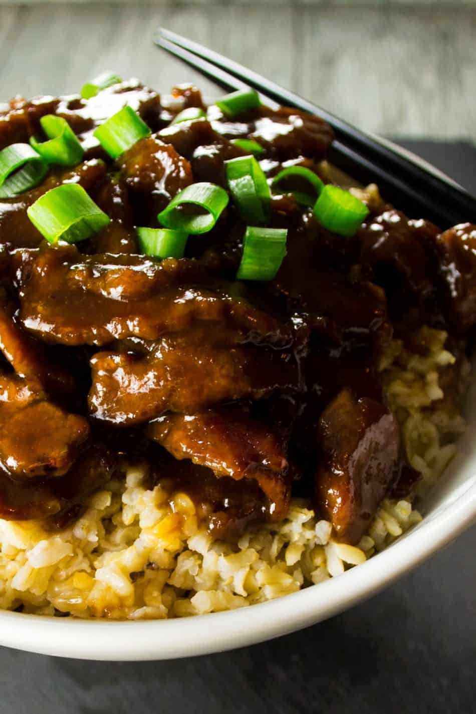 P.F. Chang Style Mongolian Beef | This sweet and spicy P.F. Chang's Mongolian Beef dish is rich with Asian inspired flavors and tastier than any Chinese take out you could have delivered. | Pack Momma | https://www.awickedwhisk.com