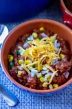 Easy Homemade Chili with beans is a classic chili recipe made with beef, beans and a little bit of spice. This simple chili recipe is ready in under an hour and is the best chili recipe to hit your dinner table!