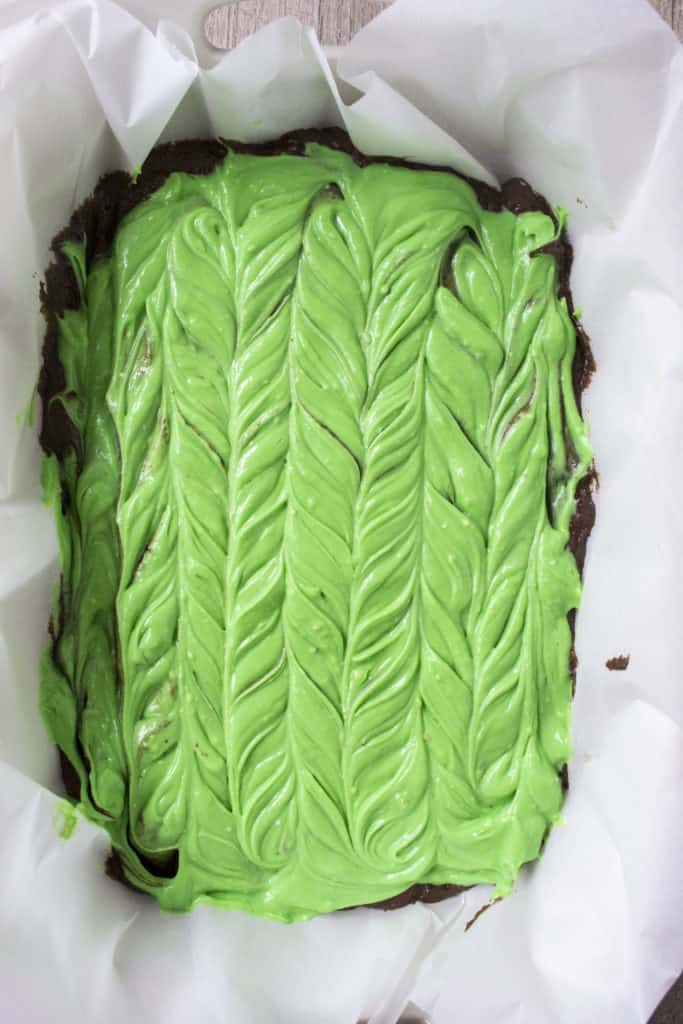 Green Cheesecake Brownie Bars in a pan, uncooked