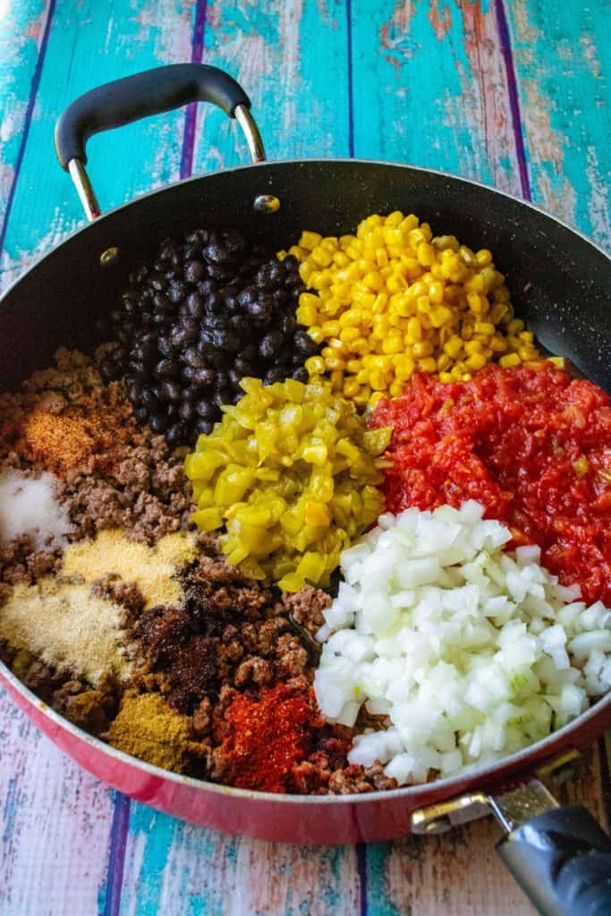 Mexican Stuffed Peppers ingredients in a skillet