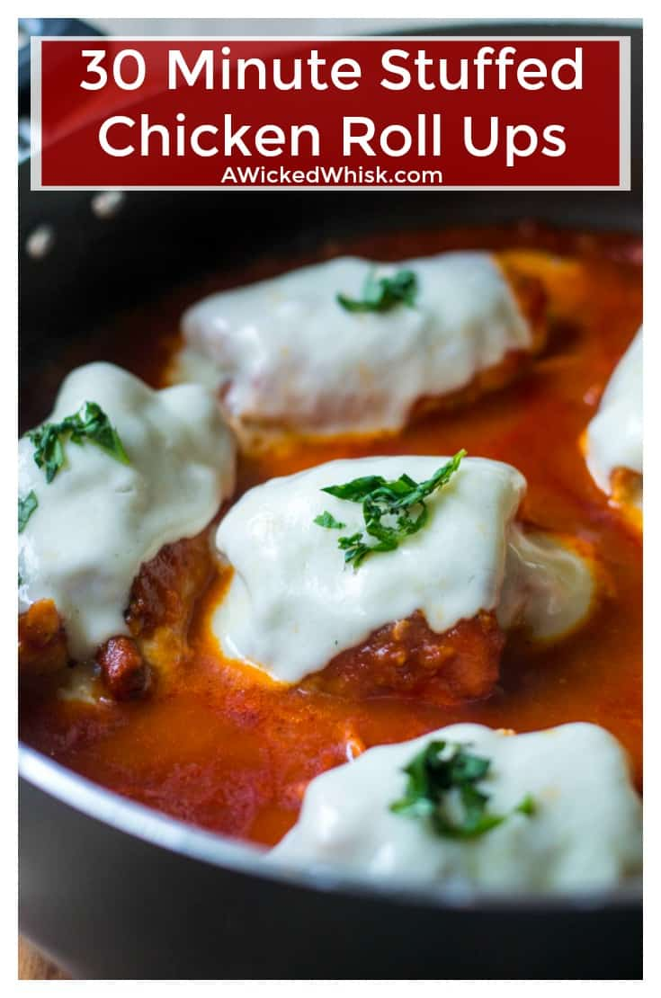 Tender chicken rolled up in prosciutto and stuffed with mozzarella cheese, sun-dried tomatoes and basil then simmered to perfection in your favorite spaghetti sauce makes these30 Minute Stuffed Chicken Roll Ups the ultimate 30 minute meal. | A Wicked Whisk | https://www.awickedwhisk.com #chickenrollups #chickenrollatini #30minutemeal #30minutechicken #chickenrolls #parmesanpolenta #30minutemeals #italianchicken #skilletchicken #skilletmeal