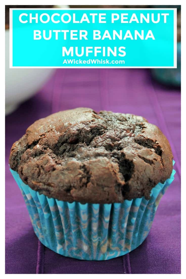 Chocolate Peanut Butter Banana Muffinsare rich, sweet and the perfect way to start any day. Moist, decadent muffins packed full of chocolate chunks, banana and smooth peanut butter make theseChocolate Peanut Butter Banana Muffins irresistible. | A Wicked Whisk | https://www.awickedwhisk.com #chocolatemuffin #chocolatebananamuffin #chocolatepeanutbutterbananamuffin #breakfastmuffin