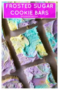 FrostedSugar Cookie Barsare soft, chewy and the easist cream cheese sugar cookies you will ever make.. and let's not forget the multi colored frosting! #frostedsugarcookiebars #frostedsugarcookies #sugarcookiebars #chewysugarcookies #chewysugarcookiebars #multicoloredfrosting #coloredfrosting #multicoloredfrostingcake #homemadebuttercream #sugarcookiebarseasy #frostedsugarcookiebarsholiday