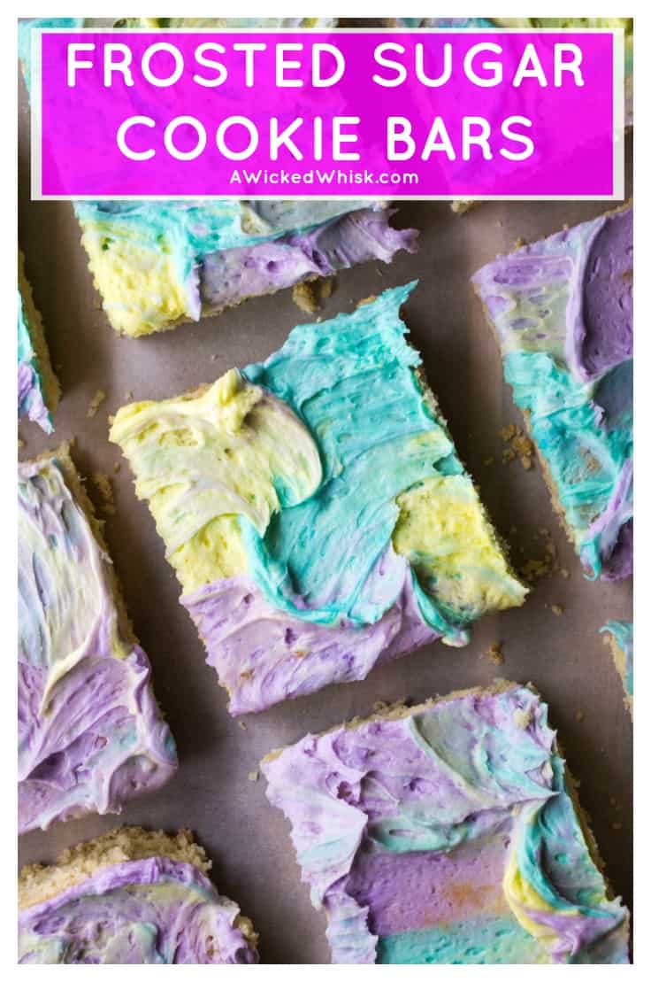 Frosted Sugar Cookie Bars are soft, chewy and the easist cream cheese sugar cookies you will ever make.. and let's not forget the multi colored frosting! #frostedsugarcookiebars #frostedsugarcookies #sugarcookiebars #chewysugarcookies #chewysugarcookiebars #multicoloredfrosting #coloredfrosting #multicoloredfrostingcake #homemadebuttercream #sugarcookiebarseasy #frostedsugarcookiebarsholiday