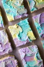 Frosted Sugar Cookie Bars are soft, chewy and the easist cream cheese sugar cookies you will ever make.. and let's not forget the multi colored frosting!