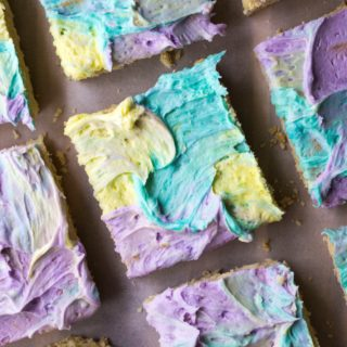 FrostedSugar Cookie Barsare soft, chewy and the easist cream cheese sugar cookies you will ever make.. and let's not forget the multi colored frosting!