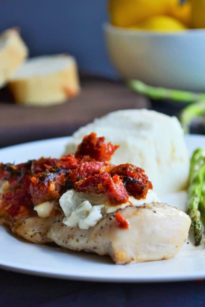 Chicken Bryan Carrabba's Copycat | Chicken Bryan Carrabba's Copycat recipe is juicy chicken with a rich lemon butter sauce, sun-dried tomatoes, creamy goat cheese and fresh basil. Perfect! | Pack Momma | https://www.awickedwhisk.com
