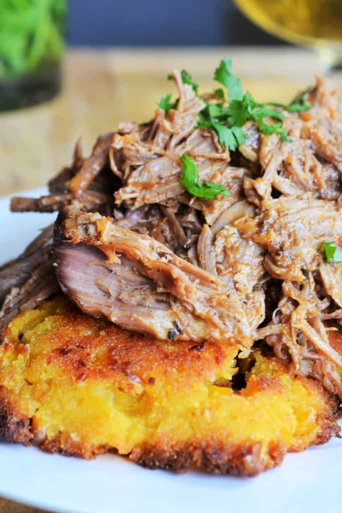 Jerk Pulled Pork with Sweet Corn Cakes | Tender Jerk Pulled Pork paired with Sweet Corn Cakes is the perfect combination of sweetness and spicy heat that definitely makes this the perfect meal. | Pack Momma | https://www.awickedwhisk.com