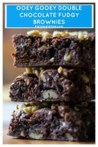 This Best Fudge Brownie Recipe are the most AMAZING chewy fudgy chocolate brownie squares of sinful chocolate brownie goodness you will ever make! Made quick and easy, this Best Fudge Brownie Recipe has a super fudgy middle and is ooey, chewy and gooey with chunks of melted chocolate running through out them. Perfect! | A Wicked Whisk | https://www.awickedwhisk.com #fudgybrownies #easybrownies #chewybrownies #homemadebrownies #doublechocolatebrownies #gooeybrownies #walnutbrownies