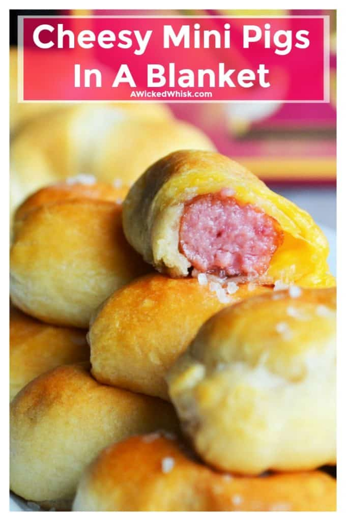 Cheesy Mini Pigs In A Blanketare mini beef smokies wrapped inside of tender croissant dough and packed full with melted cheese. Perfect for any Game Day gathering, Cheesy Mini Pigs In A Blanket give you reason to celebrate! | A Wicked Whisk | https://www.awickedwhisk.com #minihotdogs #minipigsinablanket #minicrescentdogs #fingerfood #gamedayappetizer #gamedayfood #partyfood #gamedaysnacks