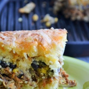 Southwest Cornbread Skillet | Southwest Cornbread Skillet is a hearty combination of sweet cornbread and seasoned pork. Comfort food at it's best! | Pack Momma | https://www.awickedwhisk.com