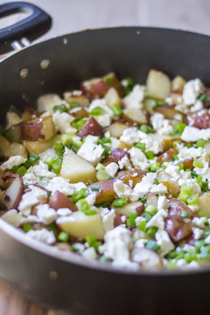 Skillet Red Potatoes with Bacon and Feta in a skillet