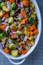 Roasted Vegetable Salad with Apple Vinaigrette is the perfect healthy side dish to any meal. Roasted vegetables, apples and walnuts and drizzled with a savory apple vinaigrette, this Roasted Vegetable Salad is an easy holiday side dish to serve up to a hungry crowd.