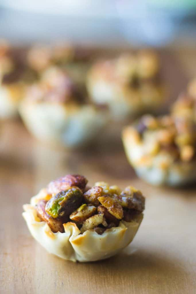 Baklava Cups | Baklava Cups are your new best friend this holiday season. Baklava without all of the mess but with all of the sweet buttery flavor.. and super cute too!! | Pack Momma | https://www.awickedwhisk.com