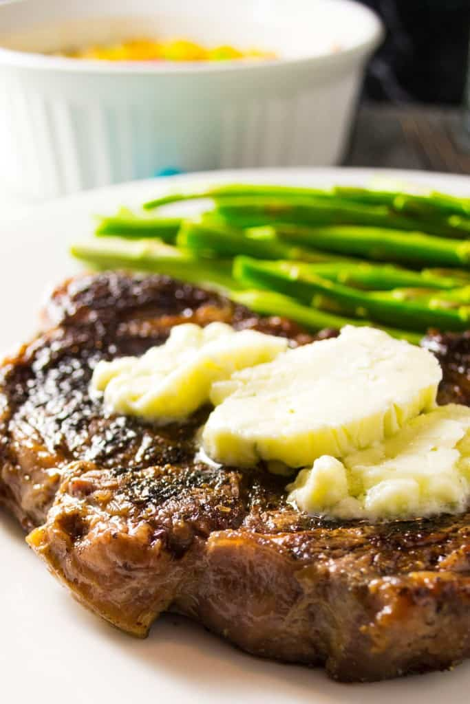 Oven Grilled Pan Seared Steak with Blue Cheese Compound Butter | Oven Grilled Steak with Blue Cheese Compound Butter is perfectly pan-seared steak topped with decadent blue cheese compound butter .. the perfect steak dinner made right in your own kitchen!! | Pack Momma | https://www.awickedwhisk.com
