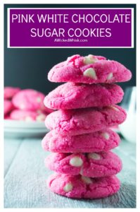 These Pink Sugar Cookies are crisp on the outside and soft and sweet on the inside.. the perfect Valentine's Day treat!! #valentines #valentinesday #pink #cookies #chocolatechipcookies #pinkfood #whitechocolate #cookierecipes #pinkcookies #whitechocolatechipcookies #softbatchcookies #softcookies #valentinesdaycookies #valentinescookies #valentinesdaydessert #sugarcookies #pinksugarcookies #softsugarcookies