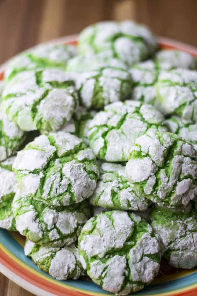 Green Christmas Crinkle Cookies piled up on a plate