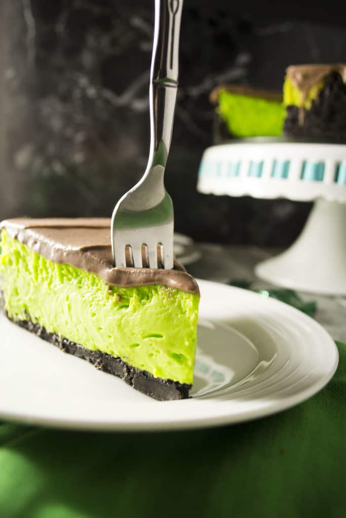Mint Chocolate Cheesecake | This bright green Mint Chocolate Cheesecake is the perfect sweet treat to bring to your next St. Patrick's Day celebration!! | Pack Momma | https://www.awickedwhisk.com