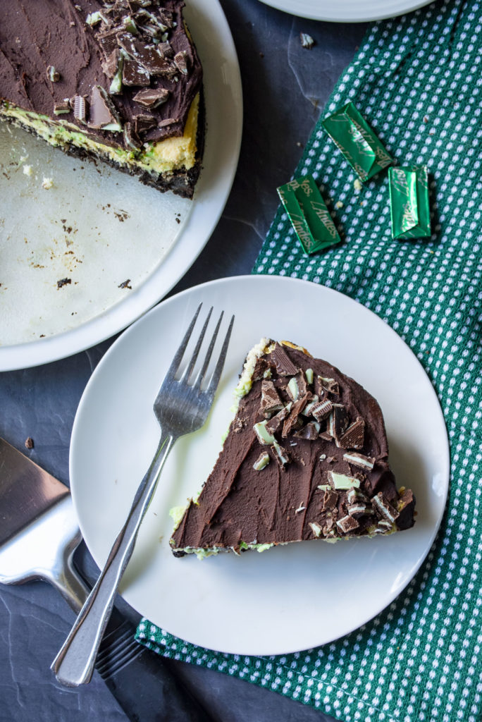 piece of mint chocolate cheesecake on a plate