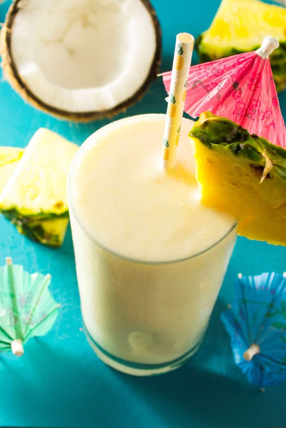 Coconut Pineapple Smoothie | This Coconut Pineapple Smoothie is the perfect way to start any morning .. fast, easy and so tropical you will think you are already on vacation. | Pack Momma | https://www.awickedwhisk.com
