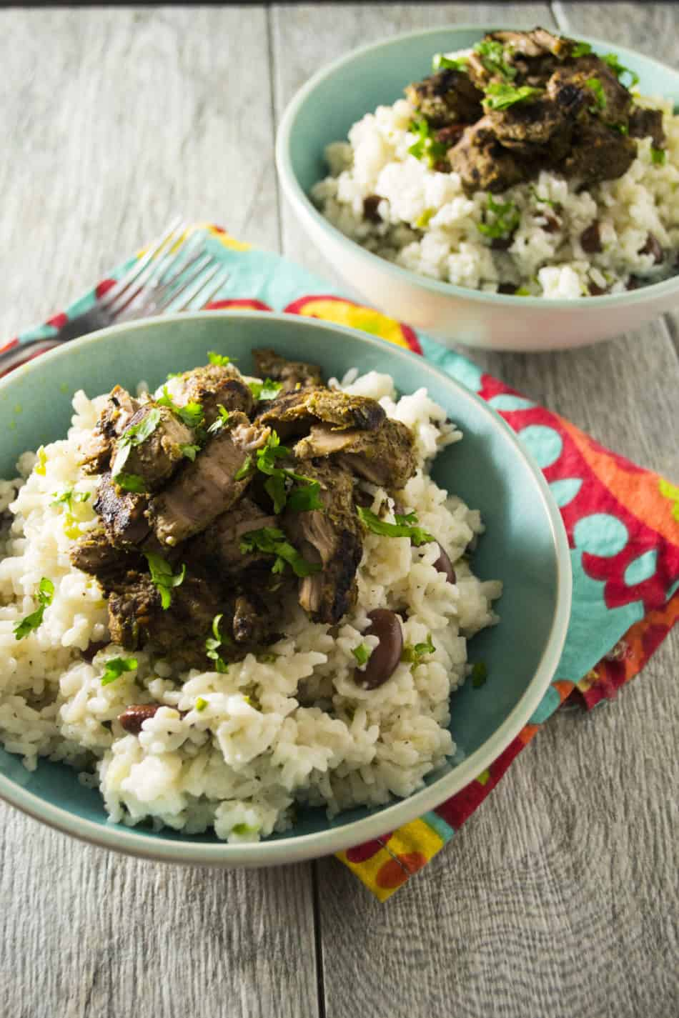 Jerk Pork with Jamaican Rice and Peas | Spice up your week with this easy recipe for Jamaican Jerk Pork with Rice and Peas. One bite and you won't believe you aren't in the Caribbean!! | Pack Momma | https://www.awickedwhisk.com