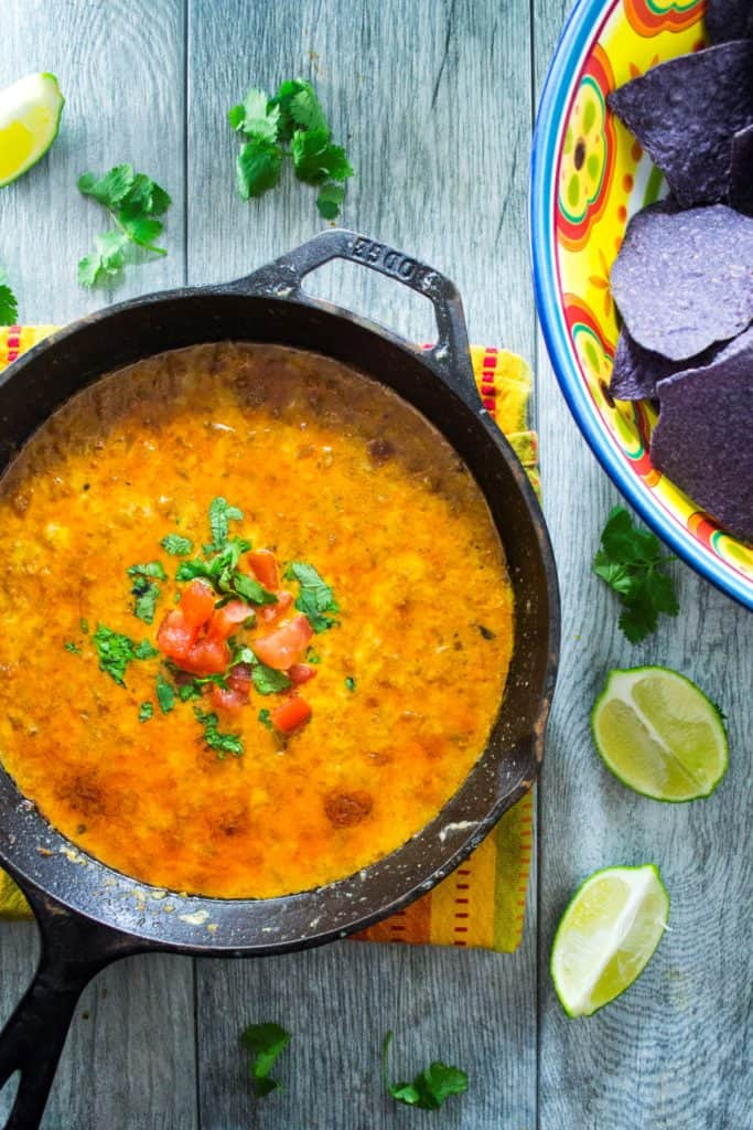 Mexican Queso Fundido | Celebrate Cinco de Mayo (or ANY day) with this Mexican Queso Fundido .. it's an easy to make oooey, gooey cheesy dip that is a crowd pleaser from the word GO! | Pack Momma | https://www.awickedwhisk.com