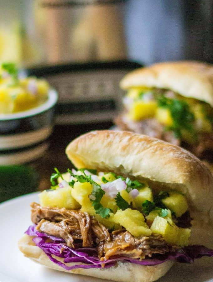 Slow Cooker Hawaiian Pulled Pork Sandwich is a sweet and spicy tropical twist on classic pulled pork sandwiches... and made with only THREE ingredients!
