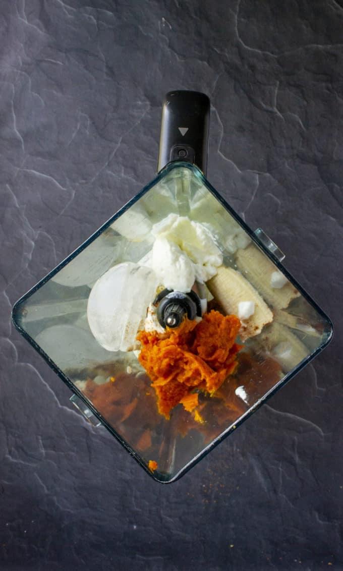 pumpkin and smoothie ingredients in a blender