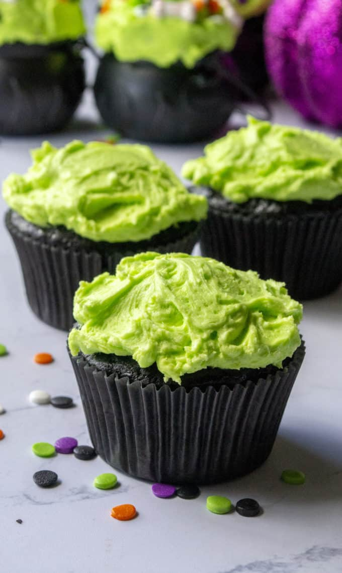 black halloween cupcakes with green frosting