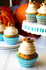 Pumpkin Cupcakes with Maple Cream Cheese Frosting | Super moist, super flavorful these Pumpkin Cupcakes with Maple Cream Cheese Frosting are decadent, indulgent perfection!... with pecans on top! | Pack Momma | https://www.awickedwhisk.com