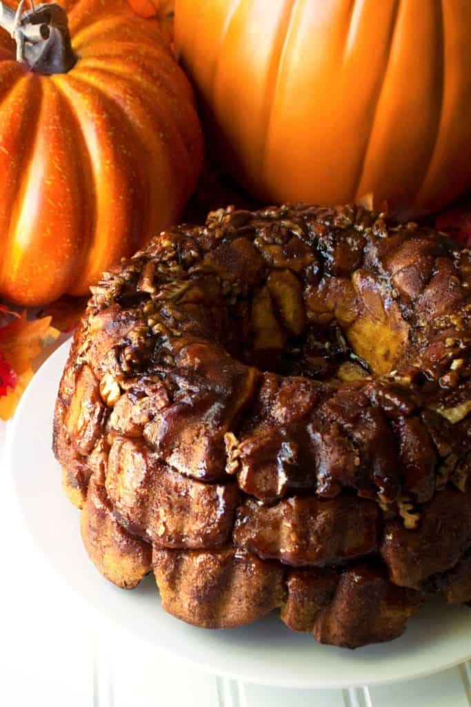 Pumpkin Monkey Bread with Salted Caramel Glaze | Pumpkin Monkey Bread with Salted Caramel Glaze is the perfect celebration of pumpkin, sweetness and spice to warm up your morning. | Pack Momma | https://www.awickedwhisk.com