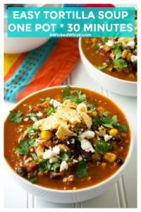 Easy Tortilla Soup is the perfect bowl of spicy comfort food to serve up to your family and friends. Bursting with tender chicken, corn, beans and all of your favorite Mexican flavors, this Easy Tortilla Soup is the ultimate ONE POT 30 minute meal. | A Wicked Whisk | https://www.awickedwhisk.com #tortillasoup #easysouprecipe #chickentortillasoup #mexicansoup #mexicantortillasoup #30minutemeal #onepotmeal