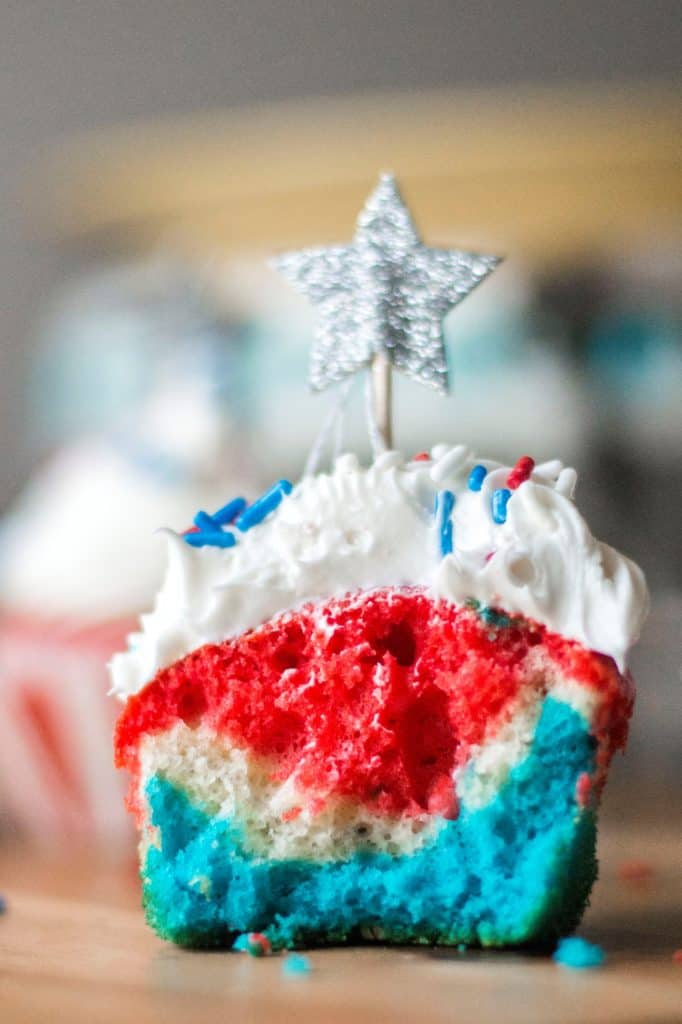 Red White and Blue Patriotic Cupcakes are the perfect Fourth of July Cupcakes to show off your American pride. Red, white and blue layered cupcakes topped with homemade buttercream frosting, these Red White and Blue Patriotic Cupcakes will be the star of every Fourth of July dessert table.