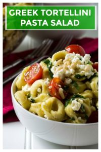 Greek Tortellini Pasta Salad is light, refreshing and so quick to put together it is the perfect side dish to bring to any of your summer backyard parties.  Creamy, tangy with a bit of pine nut crunch, this Greek Tortellini Pasta Salad will be your favorite cold pasta salad to share with family and friends. | A Wicked Whisk | https://www.awickedwhisk.com #pastasalad #greekpastasalad #tortellinipastasalad #summerpartyfood #coldpastasalad #bbqsidedishes