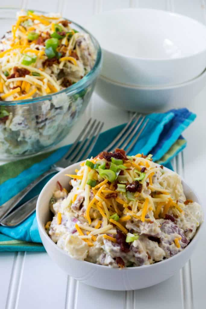 Loaded Potato Salad in a white serving bowl