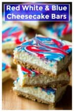 Red White and Blue Cheesecake Bars are the perfect sweet treat to show off your American spirit. Creamy cheesecake with red and blue swirls, these celebrate Red White and Blue Cheesecake Bars are the perfect dessert to celebrate Fourth of July. | A Wicked Whisk | https://www.awickedwhisk.com #redwhitebluecheesecakebars #cheesecakebars #redwhitebluefood #fourthofjulyfood #fourthofjulydessert #july4thdessert #summerdessert