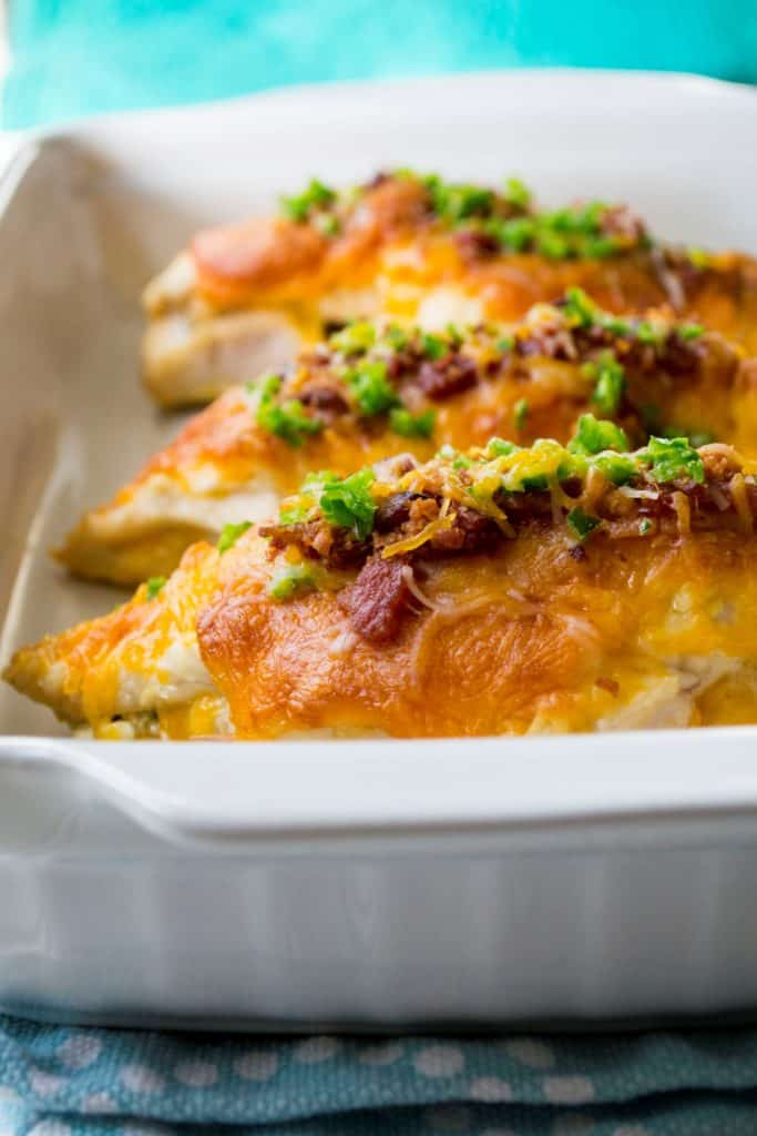 Cheesy Jalapeno Popper Stuffed Chicken in a white baking pan
