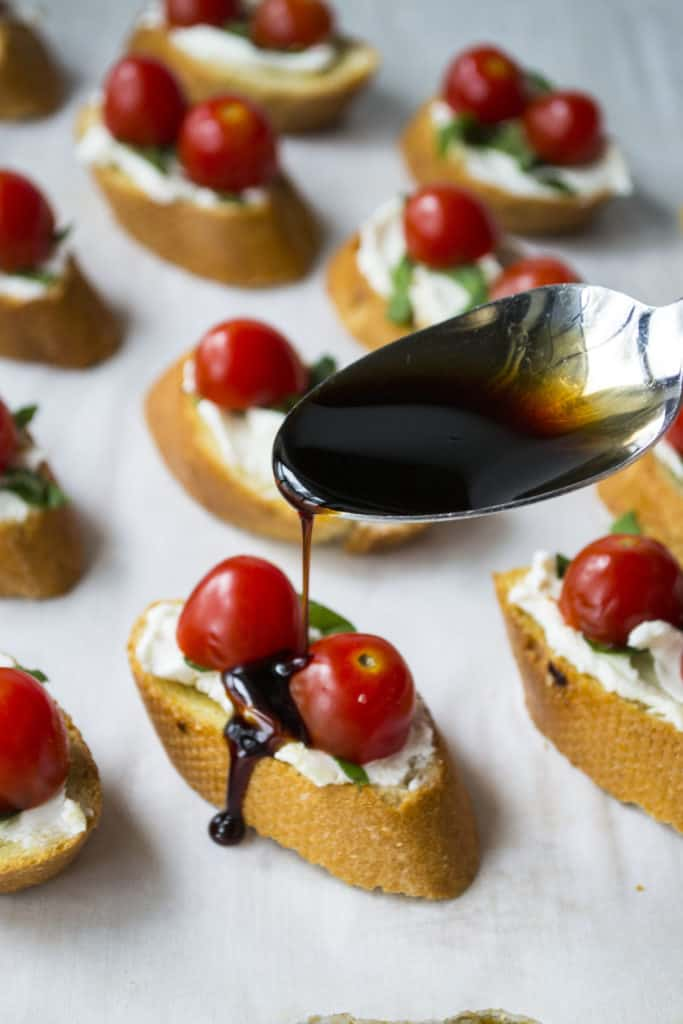 Goat Cheese Bruschetta | Goat Cheese Bruschetta is the perfect appetizer to serve at every party. Toasted bread topped with goat cheese, basil, tomatoes and balsamic glaze. Perfect! | Pack Momma | www.awickedwhisk.com