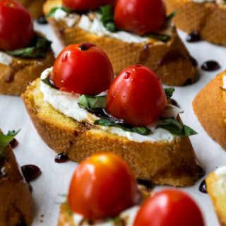 Goat Cheese Bruschetta | Goat Cheese Bruschetta is the perfect appetizer to serve at every party. Toasted bread topped with goat cheese, basil, tomatoes and balsamic glaze. Perfect! | Pack Momma | https://www.awickedwhisk.com