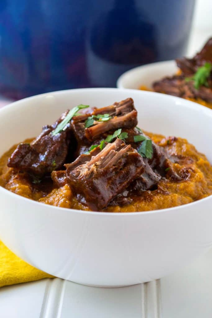Red Chile Sauce Braised Beef | Red Chile Sauce Braised Beef is tender braised beef swimming in a spicy red chile sauce that is the perfect combination of heat and delicious flavor. | Pack Momma | https://www.awickedwhisk.com
