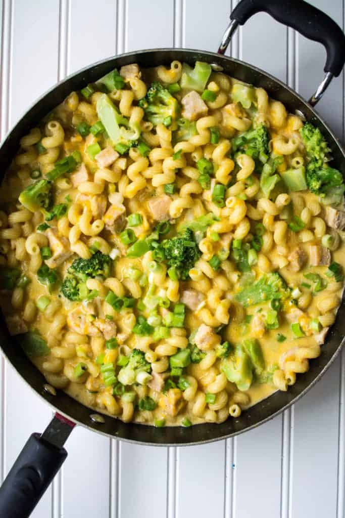 One Pot Cheesy Chicken Pasta | One Pot Cheesy Chicken Pasta is a hearty meal that's on your table in 30 minutes. Tender chicken, pasta, cheese and broccoli make this the perfect dinner. | Pack Momma | https://www.awickedwhisk.com