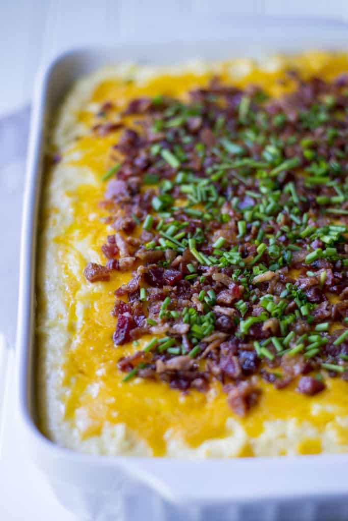 Loaded Mashed Potato Casserole | Loaded Mashed Potato Casserole is an upgraded version of your favorite potato recipe. Smothered in melted cheese and BACON, this is the best side dish ever! | Pack Momma | https://www.awickedwhisk.com