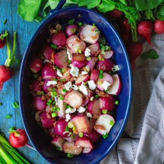 Roasted Radishes are a delicious alternative to potatoes and the BEST way to eat these tasty low carb veggies. Loaded with bacon, green onions and feta cheese, these Roasted Radishes will be your new favorite low-carb side dish!