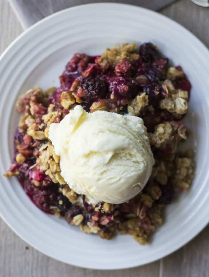Triple Berry Crisp topped with ice cream