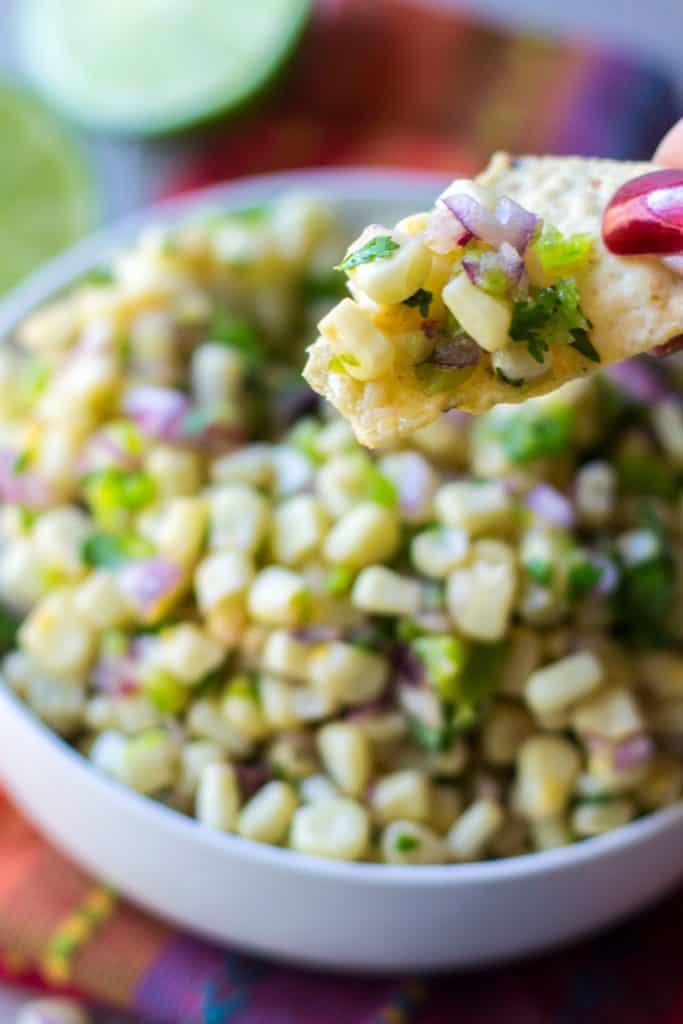 Chipotle Corn Salsa bite on a chip