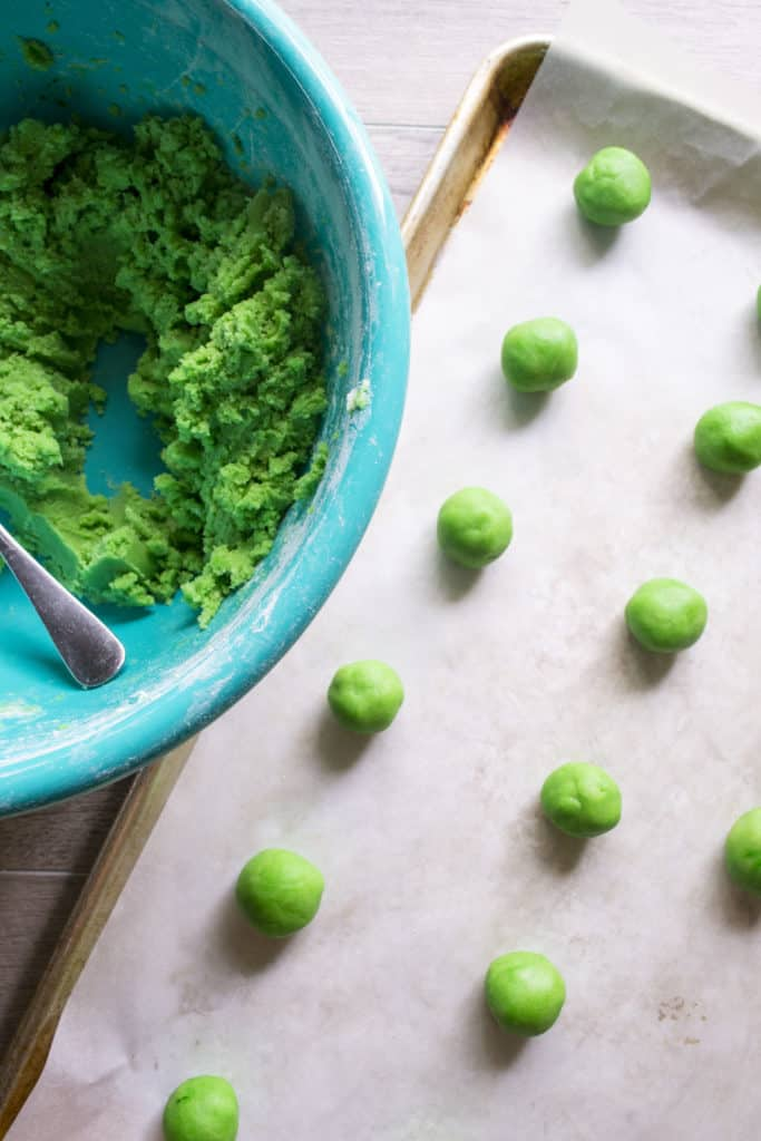Green Soft Sugar Cookies rolled into balls and laid on baking pan