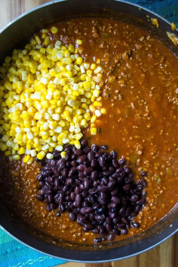 BeefEnchilada Dip ingredients in a pan