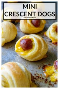 Mini Crescent Dogs are cocktail sized beef smokies wrapped inside cheddar cheese and tender crescent rolls. These crowd-pleasing pigs in a blanket are the perfect party fingerfood andalwaysgive you reason to celebrate! | A Wicked Whisk #minicrescentdogs #miniscrescenthotdogs #minicrescentdogspillsbury #minicrescentdogsrecipe #minicrescentdogswithcheese #minipigsinablanket #minipigsinablanketcrescentrolls #minipigsinablanketwithcheese #minipigsinablanketlilsmokies
