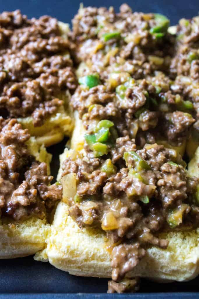 Philly Cheesesteak Sloppy Joe Sliders meat mixture spooned over the bottom of rolls